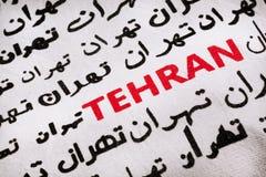 Selective focus on the word Tehran, in Farsi and English. Selective focus on the word Tehran - the capital of the Islamic Republic of Iran, in Farsi and English Stock Photo