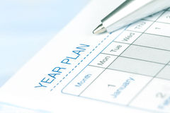 Selective focus on  year plan page of opened lined diary book Royalty Free Stock Image