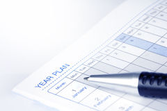 Selective focus on  year plan page of opened lined diary book Stock Image