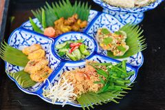 Selective focused on Thailand street food: Mi krop, Traditional Thai Crispy Noodles Dish made with rice noodles and sweet flavored. Sauce, served on banana leaf royalty free stock image