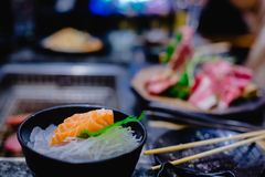 Selective focust to set of grilled Wagyu beef sushi with fish roe and Tobiko on black plate in Japanese restaurant stock photo