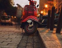Selective Photography of Red Motor Scooter Stock Photos