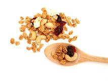 Selective soft focus granola cereal in wooden spoon and  pile of cereal Stock Image