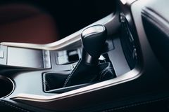 Selector automatic transmission with perforated leather in the interior of a modern expensive car. The background is blurred royalty free stock photo