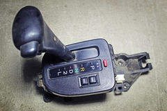 Selector lever of the automatic transmission. On a gray background royalty free stock photos