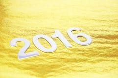 Selekcyjna ostrość lub 2016 liczb nad złotym tłem Fotografia Royalty Free