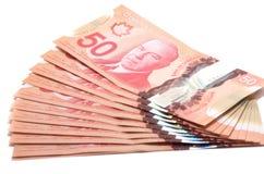 Selektiv fokus av en serie av 50 kanadensiska dollar Royaltyfri Bild