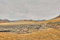 Selenar landskap som produceras av leriga volcanoes Arkivbilder