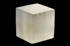 Selenite cube. White selenite cube on black background stock image