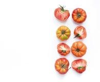 Selezione dei pomodori di cimelio su un contesto bianco Fotografia Stock