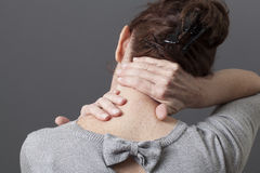 Self-acupressure for relaxing shoulder and backache Royalty Free Stock Photography