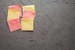 Self-adhesive notes in red color on a gray office wall Royalty Free Stock Images