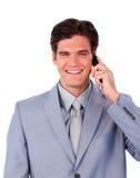 Self-assured бизнесмен говоря на телефоне стоковое фото rf