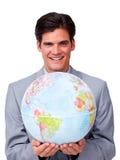 Self-assured бизнесмен держа глобус стоковые фотографии rf
