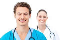 Self-assured доктора стоя в рядке стоковое фото rf