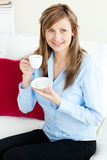 Self-assured blond businesswoman holding a cup Royalty Free Stock Photo