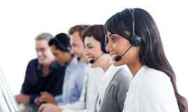 Self-assured business people using headset. In a call center Royalty Free Stock Photo