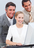 Self-assured business team working at a computer Royalty Free Stock Photography