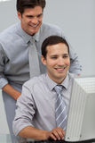 Self-assured businessman helping his colleague Stock Images