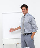 Self-assured businessman pointing at a board Stock Image