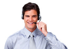 Self-assured Businessman talking on headset. Against a white background Stock Photography