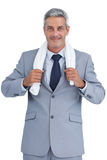 Self assured businessman with white towel on shoulders Stock Photos