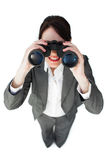 Self-assured businesswoman with binoculars Stock Photo