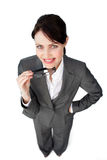 Self-assured businesswoman holding glasses Royalty Free Stock Photos