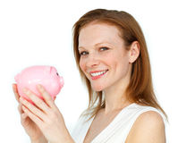 Self-assured businesswoman holding a piggy-bank Stock Photo