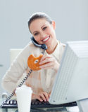 Self-assured businesswoman on phone Royalty Free Stock Images