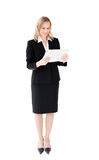 Self-assured businesswoman reading a newspaper Royalty Free Stock Images