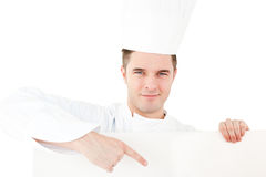 Self-assured caucasian male cook holding a placard Stock Images