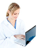 Self-assured female doctor holding a laptop Stock Photos