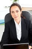 Self-assured hispanic businesswoman in her office Stock Image
