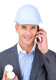 Self-assured male engineer talking on phone. Isolated on a white background Royalty Free Stock Photography