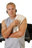 Self assured man leaning on a treadmill Royalty Free Stock Photo