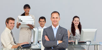 Self-assured manager with folded arms Stock Photo