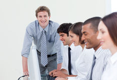 Self-assured manager and his team Stock Image