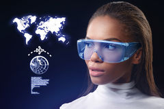 Self-assured mulatto woman using future technology eyeglasses royalty free illustration