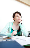 Self-assured teen girl studying at her desk Stock Image