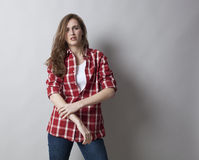 Self-assured young woman with rolled up sleeves Royalty Free Stock Photo