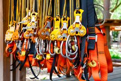 Free Self Belay Safety Equipment At A Ropes Course In A Treetop Adventure Park Stock Photo - 136588860