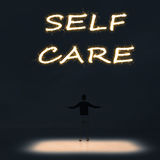 Self care. Concept of self care with a person stand in the outdoor and looking up the text over the sky in the night Royalty Free Stock Photos