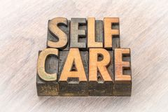 Self-care word abstract in wood type. Self-care word abstract in vintage letterpress wood type Stock Images