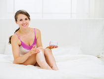 Self caring female applying creme on leg Royalty Free Stock Photo