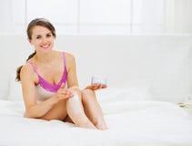 Self caring female applying creme on leg Royalty Free Stock Photo