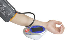 Self Checking Blood Pressure. Digital blood pressure monitor on a male's arm isolated on white background for heath care concept Stock Images
