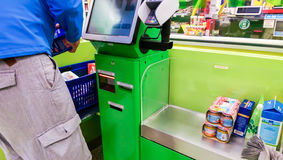 Self-checkout made by a male customer in a finnish supermarket Stock Photos