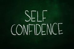 Self Confidence. Lettering, written with Chalk on Blackboard Stock Images