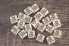 Self confidence and positive attitude concept. With Yes I Can phrase against No You Can`t phrases on wooden blocks royalty free stock photos